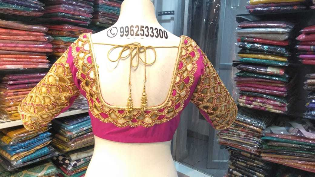 Pink Heavy Embroidery Bridal Designer Blouse At Fabloon Women's Designer Tailoring.  latest blouse neck designs boutique blouse design latest designer back blouse design blouse front neck designs  Click the below link for more updates http://boutiquesinchennai.in/2018/06/26/kora-stone-wedding-blouse/