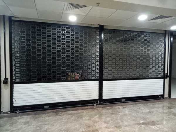 Perforated Rolling ShutterDouble dipped Perforated Rolling Shutters used for Air Ventilation and Window look with Security purposes