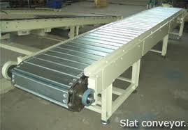 We manufacturer  Slat Chain Conveyors can be fixed or variable speed drives.This system is to convey the filled bottles out to the labelling machine and post packaging.