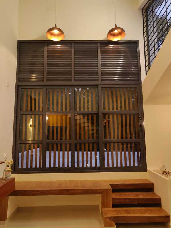 Aluminum Sliding Window with Fixed Louvers, fabricated and Installed by Excel Team. Site : Tab VillaLocation: Vannapuram, IdukkiWe Design, Engineer, Fabricate and Install entrance solutions , Automatic doors , glass façades . Calicut, Kannur, Malappuram, Wayanad, Kochi, Thrissur, Kottayam, Trivandrum, Bangalore, Mysore, Mangalore, Coimbatore and Chennai.