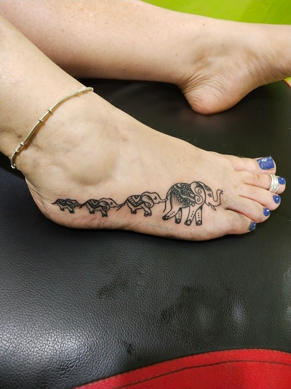 Tattoo on feet #Elephant #Fami