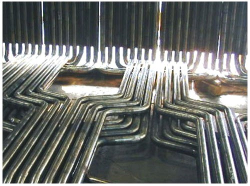 We specialize in fabrication and erection of Boiler Components like Super heater Coils- (Radiant- Super heaters, Pendant- Super heaters, Final-Super heaters) Steam Reheaters, Economizer  Coils (Plain Tubular Economizers, Finned Economizers, Cast Iron  Gilled Economisers), Feed Water Heaters, Boiler BankTubes, Steam Generating Bent to Shape Tubes and Water Wall     Panels with or without Swaged Ends, Steam Headers, Steam Drums, De-Superheaters, Evaporator Coils,  Studded Bed Coils, Spiral coils, Helical coils, HP/LP Tube Nest Steam Condensers, Spiral    Finned Tubes, Steam Piping and other Tubular fabricated products for Refineries etc. like Sample Coolers, Condensate Pots, Studded Fired Heater Tubes, Steam Condensers, Heat Exchanger  U-Tubes etc.We fabricate components based on your drawing and with high dimensional accuracy to give you ease in replacement and ready to fit components shortening the down time of boilers.