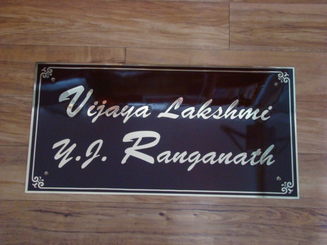 House Name Plate spectra Sign systems Supplies All Kinds Of Signage.  House Name Plate brass Etching as per the names.